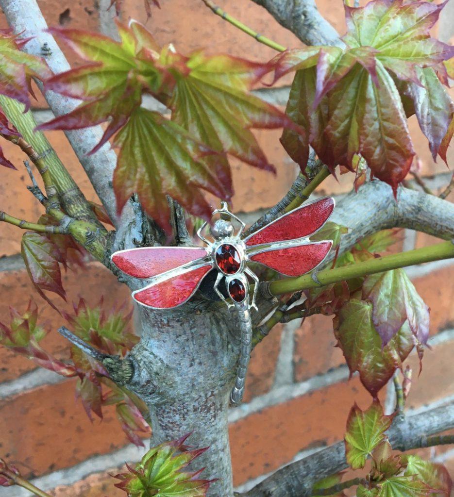 red dragonfly brooch on branch