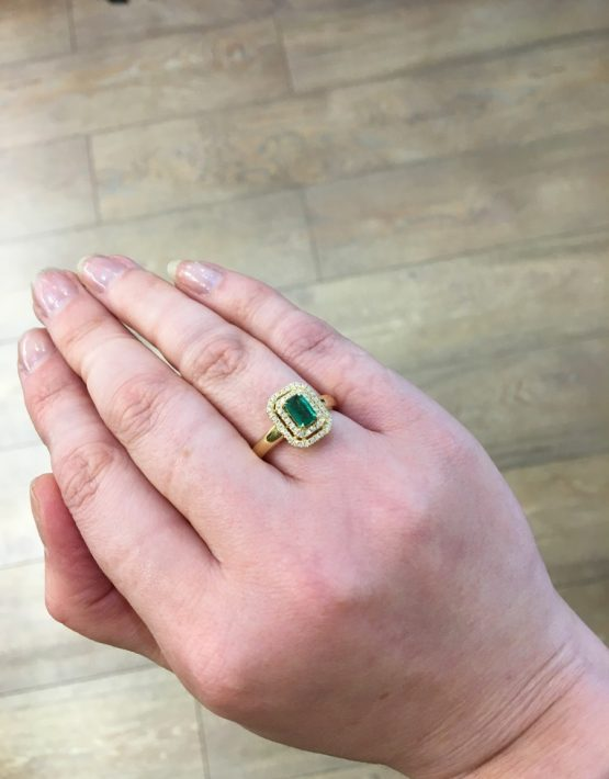 emerald and diamond ring on hand