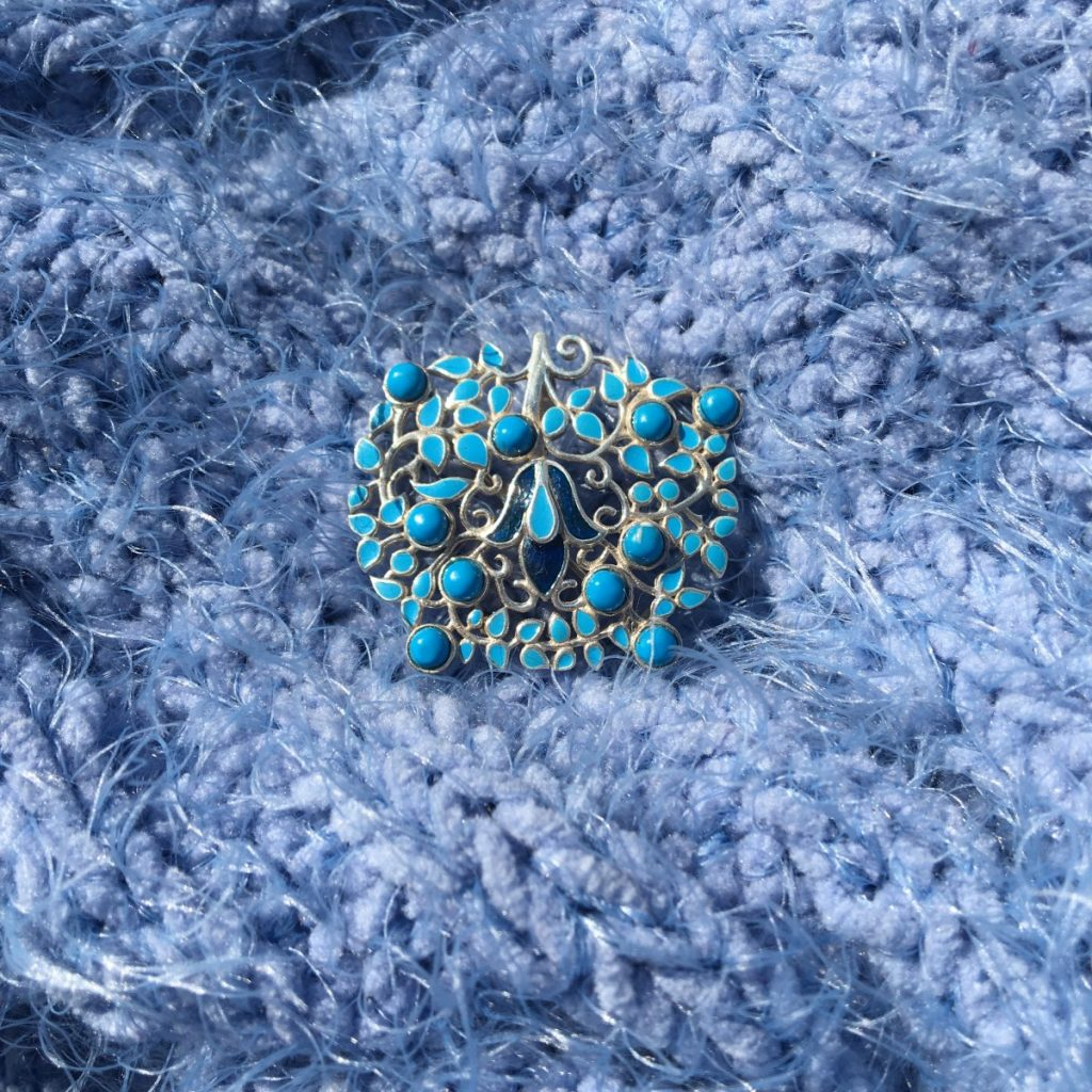 Turquoise and Enamel Brooch on blue
