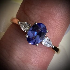 Oval Tanzanite with Pear Shaped Diamond Accents ACX927